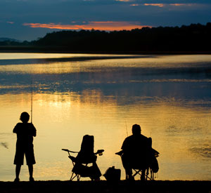 Image: Man and child fishing. Client marketing at WISH Creative.